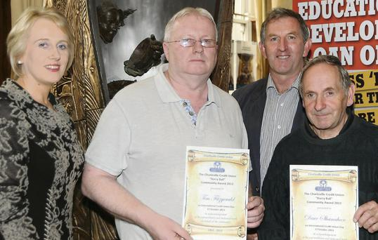 Tim Fitzgerald (left), chairman of Charleville Soccer Club and committee member, Dave Shanahan (right) who received their Harry Ball Community Awards.