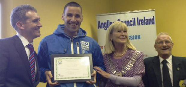 Denis Goulding receiving his the 'Angling for All' certificate from Fermoy mayor Olive Corcoran.