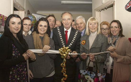 Cutting the ribbon at the official opening of the Fermoy Youth Cafe were Siobhain Mackey, Laura and Michelle Flynn, Cllr Tadgh O'Donovan, Cllr Noel O'Connor, Cllr Frank O'Flynn, Cllr Olive Cocoran, Mayor of Fermoy, Kelly Wheeler and Martina Daly.