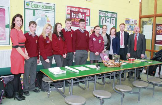 Davis College teacher Colette O'Callaghan, AIB Branch Manager, Mallow, Noreen Walsh; AIB Youth Coordinator, Mallow, Kelly-Ann Richards, Colm 'The Gooch' Cooper and Principal Denis Healy with Davis College TY students at the launch of the school's Golden Nuggests BABC as part of AIB 'Build A Bank Challenge' competition.