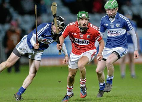 Alan Cadogan, Cork, in action against Brian Stapleton, left, and Tommy Fitzgerald, Laois. Picture: Sportsfile