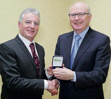 Tim Guinee, Principal Research Officer in the Department of Food Chemistry and Technology at the Teagasc Food Research Centre, Moorepark, receiving the 2013 Gold Medal Award from Teagasc chairman Dr Noel Cawley.