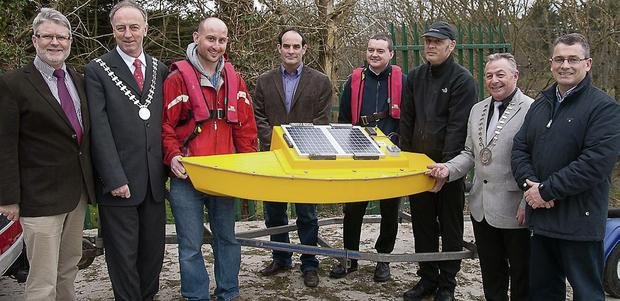 The launch of the low-cost monitoring buoy into the river Blackwater, Mallow