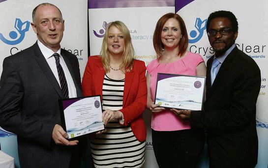 "Tony Carroll, Karen O'Shea, Yvonne Hogan (Irish Independent) and Lloyd Mudiwa (Judge) are pictured celebrating their success at the Crystal Clear MSD Health Literacy Awards for their project ""MS, Motherhood & Me""."