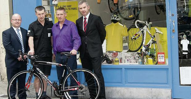 On your new bike: Paul Brichall of Pi Cycles in Mallow presents The Corkman bicyle competition winner Eugene Horgan, Newmarket with his new bike with MD John Feerick (right) and Billy Mangan, both of The Corkman. Photo: Bernadette Hayes