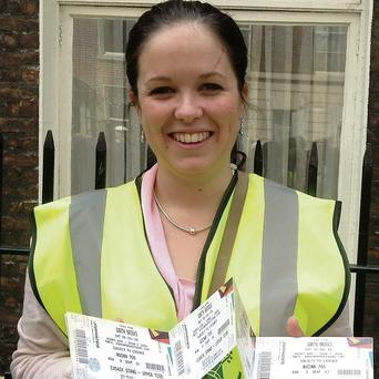 Louise Burke with some of her now defunct Garth Brooks tickets.
