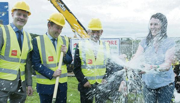 Pictured at the 'turning of the sod' were Donal O'Sullivan Principal, Colaiste Mhuire, Buttevant ,Minister Sean Sherlock, Ted Owens, CEO Cork ETB and Lisa Fitzpatrick, who today honoured the memory of her late mother by opening the bottle of champagne that she bought in 1997 in celebration of the new school