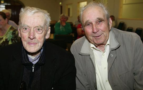 Johnny O'Mahony and John Joe Collins, Ballydesmond, attended the launch of Donie Murphy's book 'The Great Famine' at the CYMS Hall, Newmarket