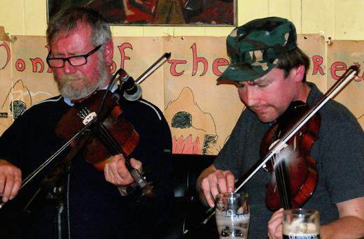 Raymond and Eoin O'Sullivan at Culture night in Scully's Bar Newmarket. Photo: Eileen O'Connor