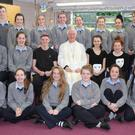 Bishop Ray Browne who visited Boherbue Comprehensive last Wednesday to launch Catholic Schools Week pictured with the 4th Year Students who took part in the ceremony. Photo by Sheila Fitzgerald