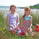 Enjoying the sunshine at the beach at Inchydoney West Cork were sisters Roisín and Aoife Doyle from Inchigeela. Picture Denis Boyle