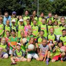 Macroom GAA Girls with coaches at their recent Cúl Camp in the Castle Grounds in Macroom