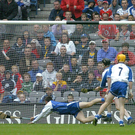 It's July, 24, 2005 and Waterford goalkeeper Clinton Hennessy fails to save a shot by Cork's Brian Corcoran, right, in the All-Ireland Senior Hurling Championship Quarter-Final, The audacious goal, a drop shot, was Cork's only goal late in the game and came from a player who had previously retired from the inter-county set-up. Cork went on to win the final against Galway. Photo: Brendan Moran