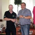 TOP: Ted O'Connell presenting Neil Hourihan, Cork, the winner of the Kevin O'Leary Perpetual Cup for Best Opel, with his Corsa A
