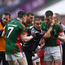 Linesman Maurice Deegan attempts to listen to Cillian O'Connor of Mayo