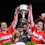 Rena Buckley, left, and Shauna Kelly of Cork lift the cup following their victory after the Ladies Football All-Ireland Senior Football Championship Final match between Cork and Dublin at Croke Park in Dublin. Photo by Sportsfile