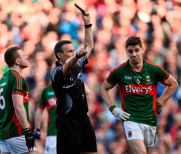 Lee Keegan of Mayo, right, is shown a black card by referee Maurice Deegan during the GAA Football All-Ireland Senior Championship Final Replay match between Dublin and Mayo at Croke Park. His tackle was a split second decision and some question if it merited the card. If he had more time to think would he do it again? Photo by Sam Barnes/Sportsfile