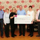 Diarmuid O'Connell presenting the proceeds from the sale of his CD 'The Songs I used To Sing' to Ann O'Mahoney and Bernie Buckley of Macroom Community Hospital and Jerry Kelleher, Margaret Golden and Tom McSweeney of St Coleman's House. Photo: Connie Cronin.