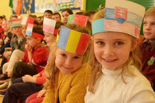 Berrings NS Junior Infants Tess Logue and Vivienne Brislone wear the national flags of our European cousins at the launch of the Blue Star Programme which was attended by Minister for European Affairs Dara Murphy. Photo by John Sheehan