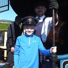 Ian O'Sullivan from Mallow getting to grips with the Emerald Isle Explorer with the help of driver Stephen Comiskey. Although Ian might not have needed that much help with the iron horse firmly in his blood - his great-grandfather, Mallow man Jackie Maher was a legendary steam engine driver after all. That's Jackie's hat Ian is proudly wearing. Photos by Eugene Cosgrove