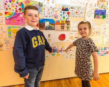 Coran Burns (9) proudly points to his picture with sister Jodie (6), Macroom
