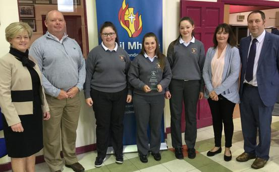 Golfing star Mairead Martin pictured at a reception in her honour at Scoil Mhuire Kanturk with her parents Brendan and Karen, sisters Cliodhna and Áine, Miriam Downey (principal) and Denis Keating (deputy principal)