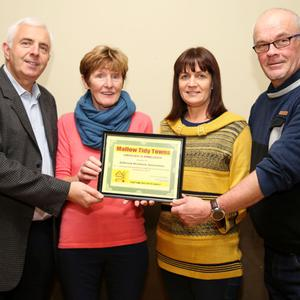 Carmel Gleeson presenting a Mallow Tidy Towns Certificate of Appreciation to Niall Cronin, Jodean Cronin and Ray O'Mullane of the Ashbrook Residents Association