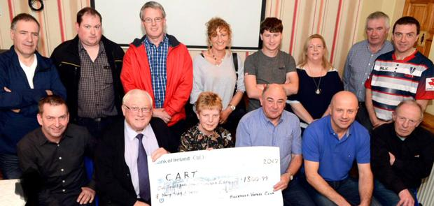 Millstreet Vintage Club who presented the €1,300.99 proceeds of their Autumn Tractor Run to the Carriganima based CART Rural Transport Service Bus