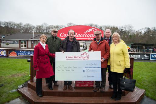 Representatives from Cork Racecourse presenting a cheque for €33,000 to the Rickie Healy Appeal