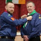 Steven Mangan (North Cork County Commissioner) presenting Ben McAuliffe with Wood Badge Beads to honour his commitment to the Kanturk Scout Group since 1979
