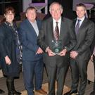 Dr Con Murphy pictured with his February Cork Person of the Month trophy. Also pictured were (L-R): George Duggan, Cork Crystal; Philip Healy, Southern; Ann-Marie O'Sullivan, AM O'Sullivan PR; Pat Lemasney, Southern; John Lehane, Lexus Cork; Deirdre and Ger Cunningham and awards organiser Manus O'Callaghan. Photo: Tony O'Connell Photography.