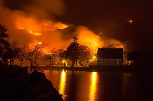 A fire raging out of control around the iconic church at Gougane Barra last April. Photo: John Delea