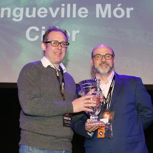 William O'Callaghan of Longueville House accepting the Alltech Commonwealth Cup for their Cider Mór from head judge Geraóid Cahill