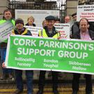 Tony Wilkinson (far left), Ted Horgan, Chairman of Cork Parkinson's Support Group and Michael Collins TD. Tony wants the HSE to provide three trained nurses to help over 900 Parkinson's patients in Cork. Tony and the support groups are willing to fundraise for the training of the trained nurses