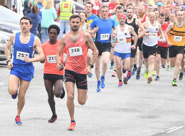 An international dimension to the inaugural Duhallow 10 mile Road Race sees eventual winner and Ethiopia native Miko Tonosa (DSDAC) numbered 217 shadow runner-up and Moldovan native Sergiu Ciobanu (Clonliffe Harriers) and third-placed Alan O'Shea (Bantry AC) in Newmarket. Picture JohnTarrant