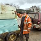 A relieved Banteer farmer, Eddie Taaffe, collects two bales of food for his 200 cattle at the Dairygold Branch in Millstreet where food was distributed to local farmers for their cattle which had been shipped in from the UK due to the shortage crisis after recent inclement weather. Picture: John Delea