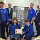 The team from Coláiste Mhuire, Buttevant,which won the prize for best presentation, and their teachers/mentors with Minister Stanton, former Mallow Rotary president Brendan O'Shea (far right) and district governor Rotary Ireland Garth Arnold (blue polo shirt)