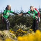 Helping to launch The Mercy Hospital Foundations Galtees Climb to Remember are sisters, Niamh and Orla Walsh from Kildorrery who will join the climb on Sunday, June 10, in memory of their father, Garry Walsh. Photo: Cathal Noonan