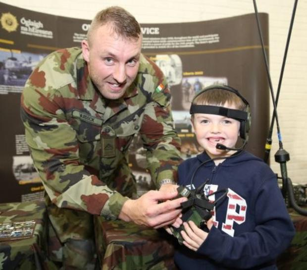 Conor Noonan, Mallow, using a PRR Radio courtesy of Sgman Patrick Murdock of the Defence Forces at last year's Munster Maths & Science Family Fair at Mallow GAA Complex