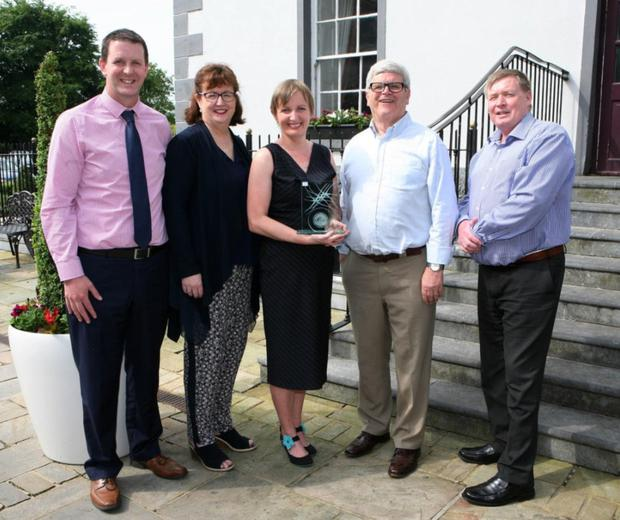 Vera Twomey receiving her award with (L-R) - Paudie Donegan, Lexus Cork; Ann-Marie O'Sullivan, AM O'Sullivan PR; Manus O'Callaghan, awards organiser and Pat Lemasney, Southern