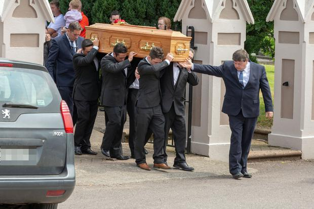 Patrick 'Ginty' O'Donnell's coffin is moved from Ballindangan Church for burial