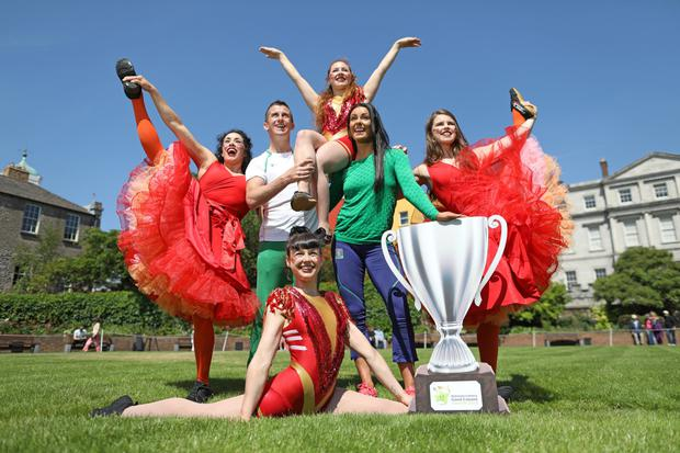 Olympic bronze medallist Rob Heffernan and his wife and coach Marian launching the inaugural National Lottery Good Causes Awards with members of the Fidget Feet aerial dance group
