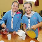 Maria O'Sullivan and Cara Courtney busy at the Boherbue Girl Guides Old Time Tea Room fundraiser