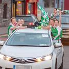 Macroom Ladies Football U14: The Cup is aired as Macroom Ladies Football U14's Team celebrate as they drive through Macroom on Sunday evening after taking the U14's Mid Cork Finals from Shamrocks in Ballinora, the final score being 8-4 to 2-6. Pictures by John Delea.