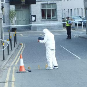 Gardai examine the scene on Bridge St, Mallow on Friday morning after the death of Conor Quinn