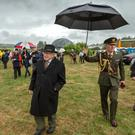 President Michael D. Higgins does a walkabout with Peader O Riada at the Féile na Laoch Festival in Coolea, just after sunrise on Wednesday morning. Pic: John Delea