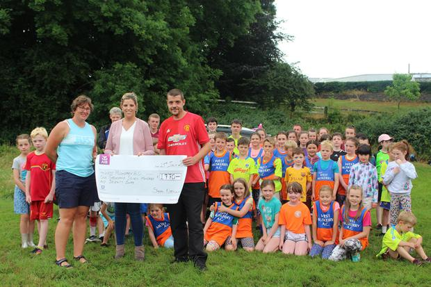 Cheque presentation: Members of the West Muskerry AC Club with coach, Collette O'Riordan (left), Sharon and Mark Coleman