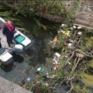 Volunteers from 'Fermoy A Cleaner Town' clearing litter from the sluice gates and south bank of the River Blackwater in the town last Saturday.