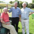 Billy O'Reilly, Michael Ryan and Eddie Collins take time out at the Kilbrin GAA Golf Classic