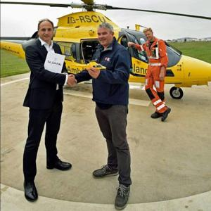 ICRR CEO John Kearney (front, right); John Parnell, sales and marketing director with Sloane Helicopters; and pilot Dave Usher (back) following the signing of a contract for the AW-109 Community Air Ambulance